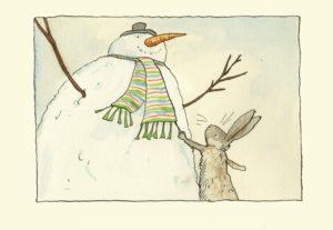 Carte de voeux avec texte en anglais représentant un lapin qui touche l'écharpe d'un bonhomme de neige