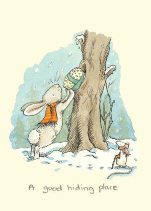 Carte de voeux avec texte en anglais représentant un lapin accompagné d'une petite souris cachant un cadeau dans un arbre